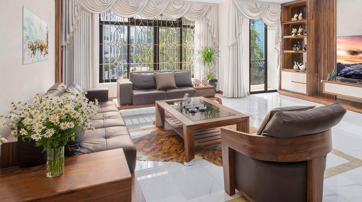 Bàn ghế gỗ phòng khách đẹp kết hợp giữa văng  và ghế chủ lưng tựa tròn