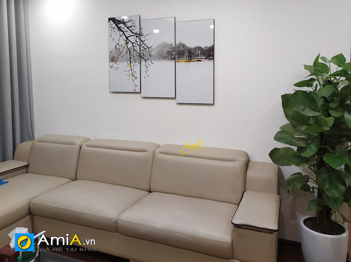 Hình ảnh Tranh treo trên ghế sofa góc da phòng khách đẹp sang trọng